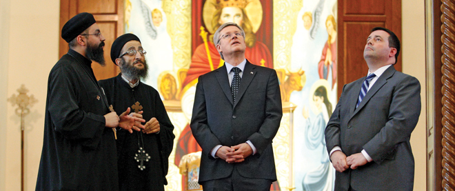 Canada's Prime Minister Stephen Harper (C) and Jason Kenney (R), Minister of National Defence and Multiculturalism, tour the Canadian Coptic Centre with Fr. Angelos Saad and Fr. Pishoy Wasfy in Mississauga January 13, 2011. Harper condemned the bombing which killed 23 Coptic Christians in Egypt during a New Year's Eve mass and prompted a number of churches in Canada to go on high alert during the holidays. REUTERS/Mike Cassese (CANADA - Tags: POLITICS RELIGION)